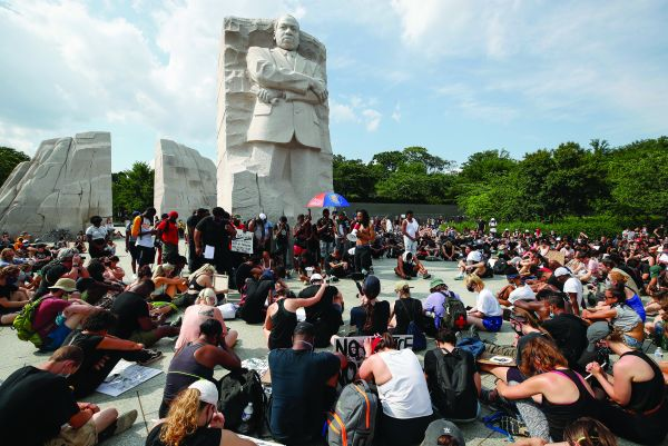 Demonstrators protest, at the Martin Luther King Jr Memorial in Washington, on 6 June 2020 over the death of George Floyd